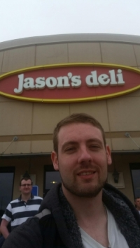 Jason in front of Jason's Deli