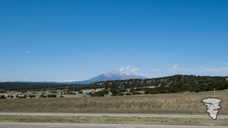 Rocky Mountains in the background, driving along the I25