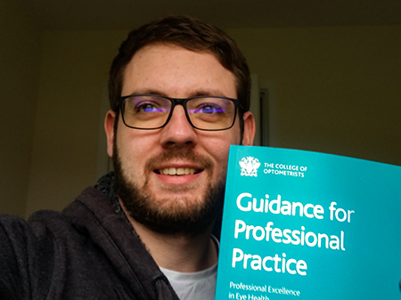 Jason with the College of Optometrists' Handbook